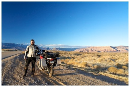 Standing by my old motorcycle along the road in southern Utah